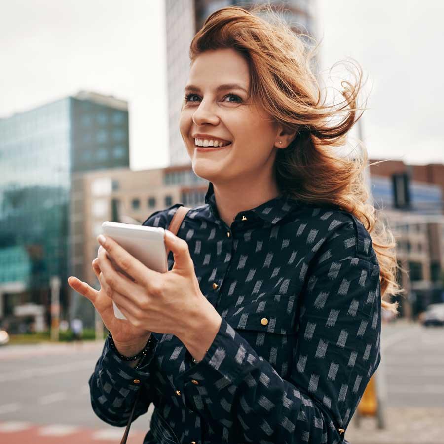 Business woman using Ci anywhere - TechnologyOne